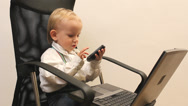 Stock Video Footage of Little kid connected to technology, with laptop and mobile