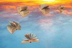 Books fly over sunset clouds Stock Illustration