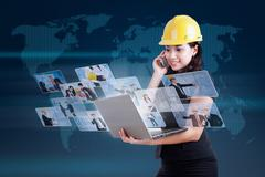 Attractive contractor calling and looking at digital photos Stock Illustration