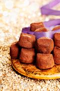plate of chocolate confectionery with ribbon - stock photo
