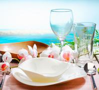 stylish place setting with orchids - stock photo