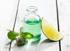cool and refreshing mint essential oil - stock photo