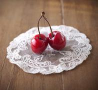 two delicious ripe cherries - stock photo