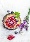 delicious redcurrant tart in fluted pan - stock photo