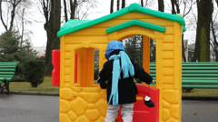 Little house owner go in colored home, close door in the amusement park Stock Footage