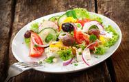 Serving of fresh mixed salad Stock Photos