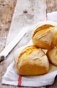 crusty golden bread rolls - stock photo
