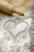 Hand drawn heart in flour Stock Photos