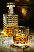glass and bottle of hard liquor - stock photo