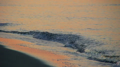 Sea waves reflecting the first light of dawn - HD1080i Stock Footage