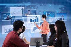businessman explaining bar chart to team - stock illustration