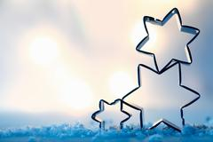Star cookie cutters on snow crystals Stock Photos