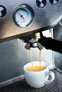 coffee machine dispensing coffee - stock photo