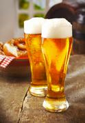 Stock Photo of two tall glasses of golden ale