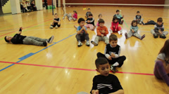 Stock Video Footage of Children doing free exercises in sports hall,sports recreation