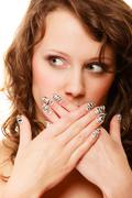 Surprised woman face, girl covering her mouth over white Stock Photos