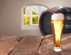 glass of beer and a cask - stock photo