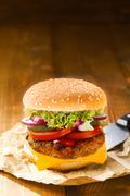 tasty hot hamburger with onion, meat and salad - stock photo