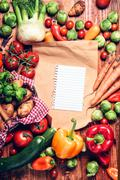 Garden fresh vegetables and blank brown paper Stock Photos