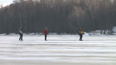 Skaters on a sea ice viewing on Ice Sailing Stock Footage