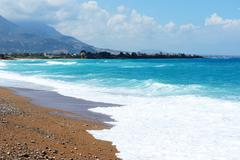 the beach on ionian sea at luxury hotel, peloponnes, greece - stock photo
