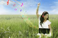 Stock Illustration of attractive female listening to music on green field
