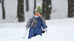 Cute litle kid standing in the snow Stock Footage