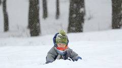 Cheerful child playing in the snow Stock Footage