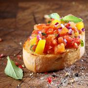 cooking colourful bruschetta - stock photo