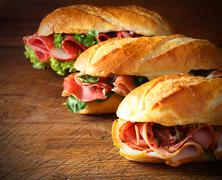 Assorted delicious baguette sandwiches Stock Photos