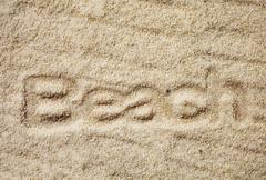 Golden sand with the indented word - beach Stock Photos