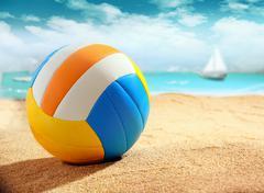 Colourful beach ball on the sand Stock Photos