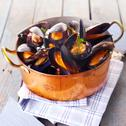 Stock Photo of copper pot of gourmet mussels