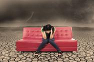 Stock Illustration of hopeless female on red sofa at dry ground