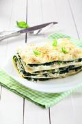 Fresh baked vegetarian spinach lasagna on a plate Stock Photos