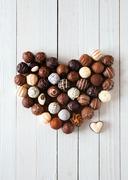 Heart shape made with various chocolate truffles Stock Photos