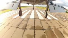 Plane landing - view from undercarriage Stock Footage