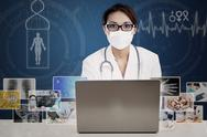 Stock Illustration of asian doctor looking at digital photo on laptop