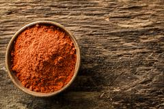 bowl of ground red cayenne pepper - stock photo