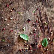 Background of peppercorns and basil Stock Photos