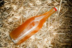 bottle of delicious natural homemade nectar - stock photo