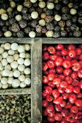 Different varieties of peppercorns Stock Photos