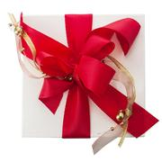artistic red bow with gold braid on a gift - stock photo