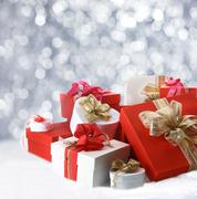 Christmas gifts against sparkling party lights Stock Photos