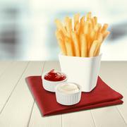 Crisp fried potato batons or chips Stock Photos