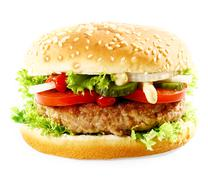 cheeseburger with meat, onion, salad and ketchup - stock photo