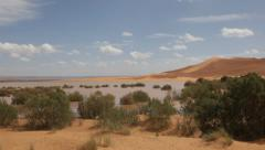 Pan view of Erg Chebbi lake; Erg Chebbi desert, Maroc - stock footage