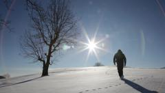 A man walks in a snowy field - HD1080p Canon 5Dmk2 Stock Footage
