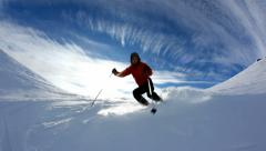 Freerider skier moving down in snow powder; fish-eye lens. HD1080p Canon 5Dmk2 Stock Footage