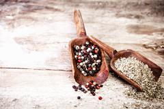 Dried spices on a grunge rustic wooden background Stock Photos